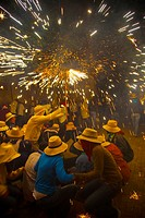 ´Correfoc´ Catalan traditional festival 16th August where people dressed as devils light fireworks while dancing in the street, La Bisbal d´Emporda, B...