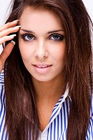 beauty brunette woman face with blue eyes and blue shirt