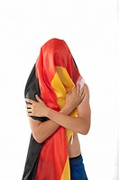 Young man wrapped in Germany flag