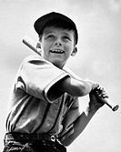 Close_up of a boy waiting to swing the baseball bat