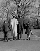 Family with two children walking in park