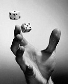 Close_up of a person´s hand tossing two dice