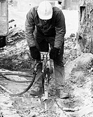 Worker using a pneumatic drill
