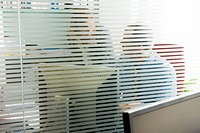 Colleagues having private conversation in office