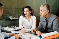 Clients discussing paperwork with businessman
