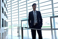 Businessman standing in lobby