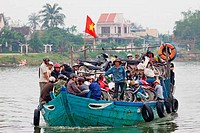 Commuters on a boat, Hoai River, Hoi An, Vietnam