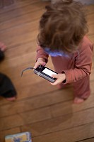 Toddler looking at digital camera
