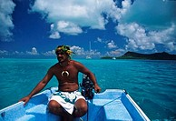 French Polynesia, Bora Bora, man on boat in traditional clothing