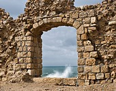 Window in Ruin Wall Showing the Mediterranean Sea