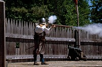 JAMES FORT RECONSTRUCTION.A demonstration of how a matchlock musket is fired, inside the triangular fort that sheltered the settlers from 1607 until t...