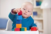Baby boy playing with toy blocks