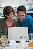 Germany, Berlin, Man and woman using laptop