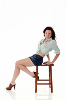 Attractive woman posing on stool