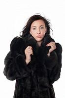 Attractve woman in mink coat