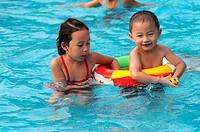 swimming boy and girl