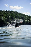 Woman swimming in lake