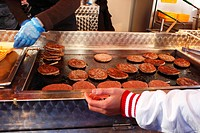 England, Merseyside, Liverpool. Burgers and fries being prepared in a van on Anfield Road on a match day in Liverpool