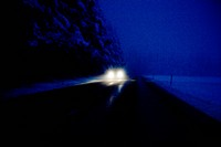 A car on the road on a winter night, Sweden.