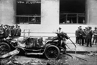 WALL STREET BOMBING, 1920.Police officers standing near a wrecked car, after the Wall Street terrorist bombing on 16 September 1920.