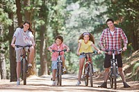 Family with bicycles in woods