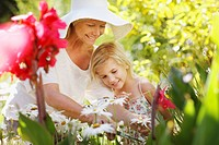 Grandmother and granddaughter in garden (thumbnail)