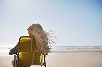 Woman&#8217;s hair blowing in wind on beach
