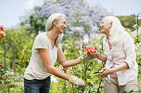 Senior women gardening
