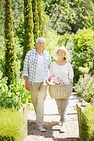 Couple walking in garden