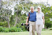 Senior couple with golf clubs
