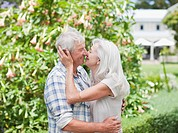 Senior couple kissing in garden