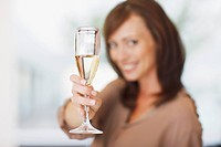 Close up of woman holding champagne flute