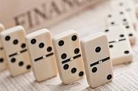 Dominos on financial newspaper