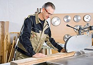 Carpenter working at circular saw