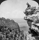 GRAND CANYON: SIGHTSEERS.A woman and a man on a cliff overlooking the Grand Canyon in Arizona. Stereograph, 1903.