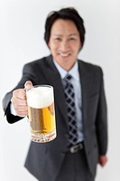 Businessman holding beer in a mug