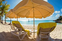 Beach chairs and umbellas on Meads Bay Beach on the caribbean island of Anguilla in the British West Indies