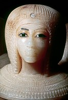 EGYPT: ALABASTER HEAD.Carved alabaster head of a royal woman, from the lid of a canopic jar found in a tomb in the Valley of the Kings, Egypt, 18th Dy...
