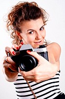 beautiful woman in a sailor´s shirt with camera