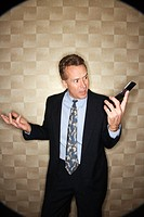 Angry Businessman on Cell Phone