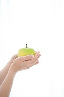 Close Up of Woman Holding Apple