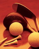 Golf clubs and balls, close up, sepia toned