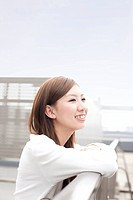 Young woman smiling on rooftop, Japan