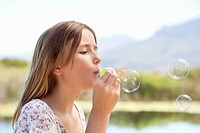 Close_up of a girl blowing bubbles