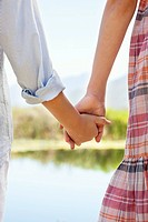 Close_up of siblings holding hands