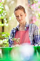 Girl gardening and thinking