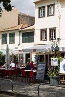 Zona Velha FUNCHAL MADEIRA Tourist couple dining at Old Town restaurant outdoors