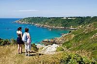 Moulin Huet Bay ST MARTIN GUERNSEY Woman and girl looking at view bay and southern coast