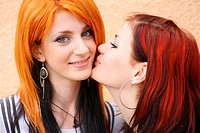 redhead women outdoors in the street against wall