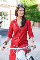 Beautiful young woman cycling